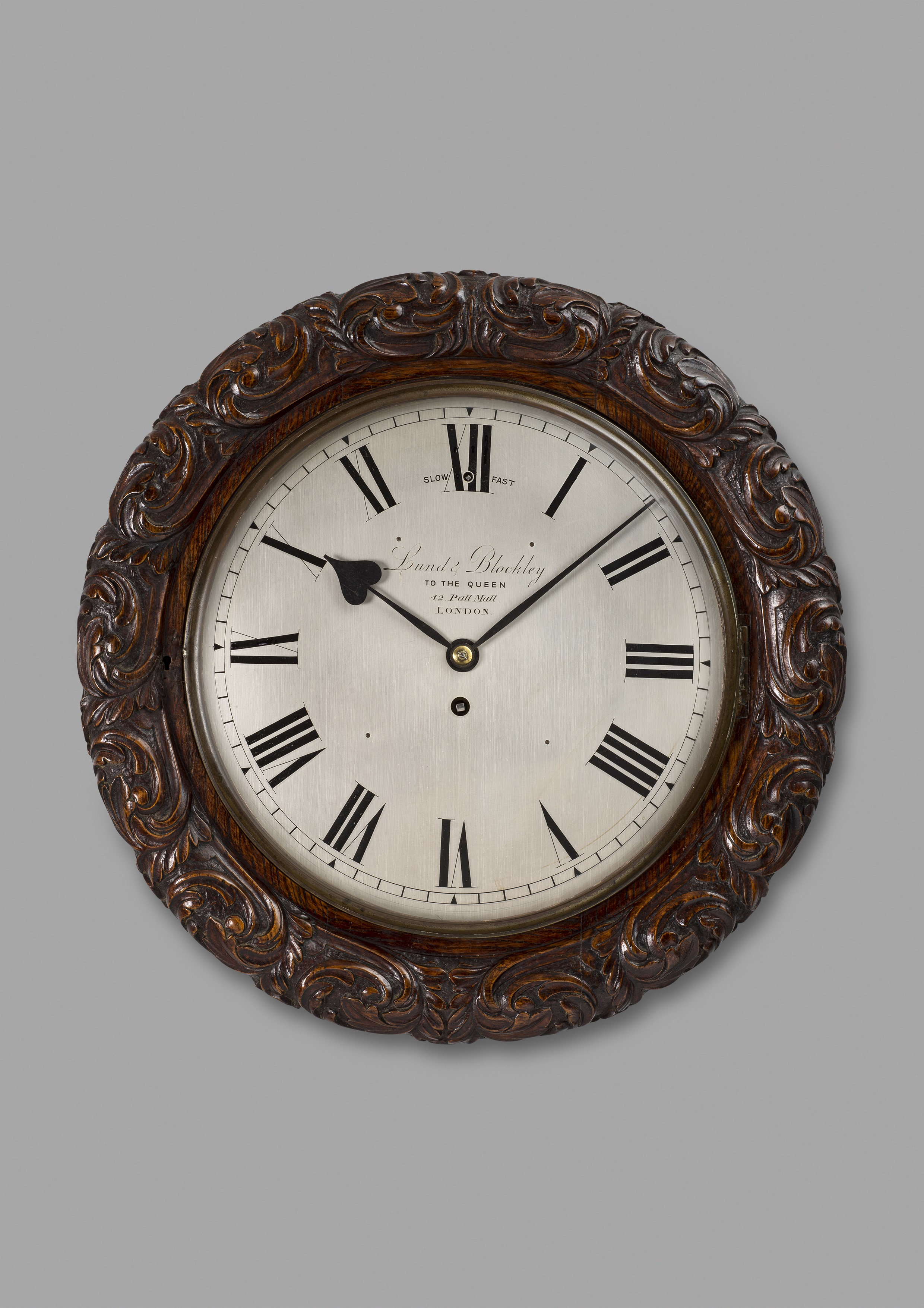 Carved oak wall clock by Lund & Blockley, London. Circa 1875. Raffety Ltd.